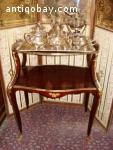 Elegant antique tea table with bronze decorations