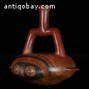 incredible ceramic stirrup vessel in the form of a stylized