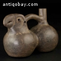 Pre-Columbian Moche, double bodied parrot whistling vessel