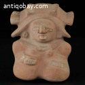 Pre-columbian Molded buff-brown pottery seated figure