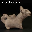 Pre-columbian vessel in the form of a coyote. C-019