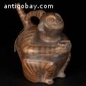 Pre-columbian Viru, sitting monkey whistling vessel